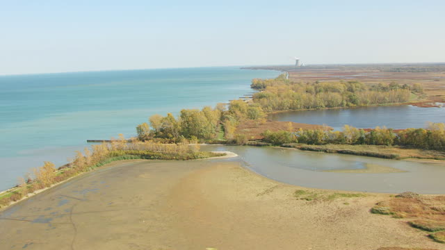 ws td aerial view of wetlands at ottawa national wildlife refuge / ohio, united states - lago erie video stock e b–roll