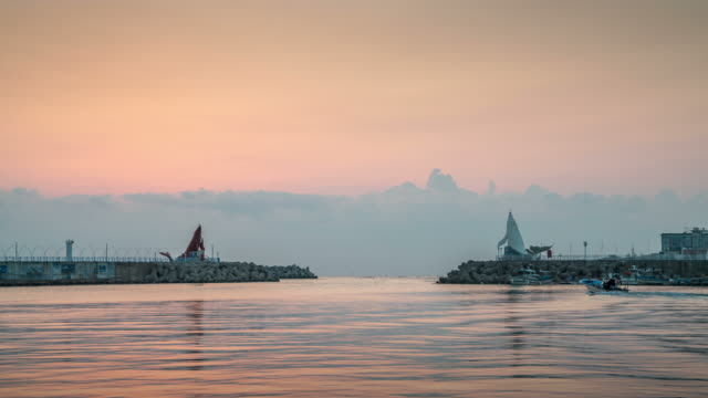 vidéos et rushes de view of whale lighthouse with seascape at sunrise in jeongja-port, ulsan - lighthouse
