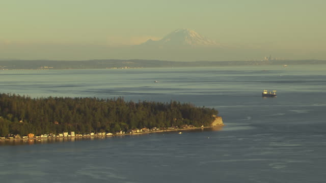WS AERIAL ZI View of Whidbey Island oast in front of Mount Rainier / Washington, United States