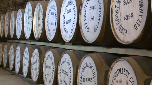 ms view of whisky casks in warehouse / rothes, speyside, scotland - scotch whiskey stock videos & royalty-free footage