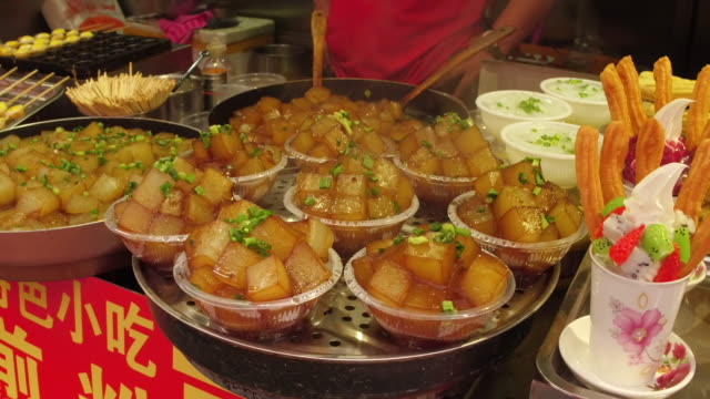 a view of white gourd salad in famous wangfujing snack street on may 4 2017 in beijing china wangfujing is a main business street for tourism next to... - gourd stock videos & royalty-free footage
