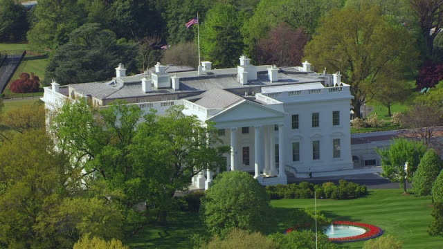 WS AERIAL POV View of White House and lawn in foreground / Washington DC, United States