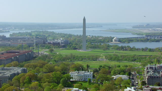 WS AERIAL POV View of White House and Washington Monument with city / Washington DC, United States