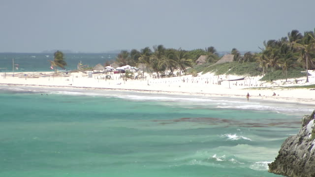 ws view of white sand beach and hotel complex next to / tulum, quintana roo, mexico - tulum mexico stock videos & royalty-free footage