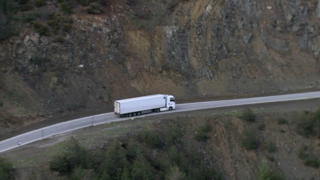 ws aerial zi ts view of white truck on road near epiros / epiros, thessalia, greece - truck stock videos & royalty-free footage