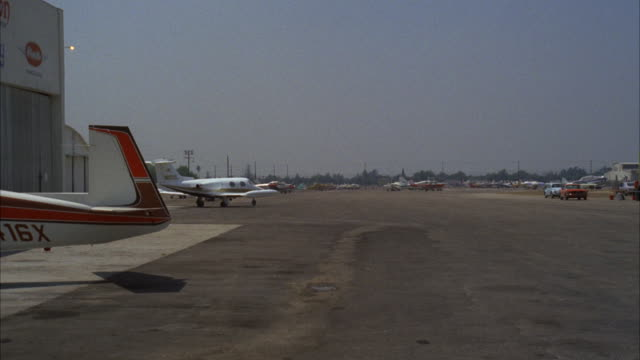 ws view of whiteman airport with small airplanes parked - runway stock videos and b-roll footage