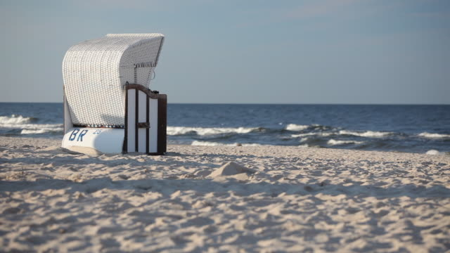 WS View of Wicker beach chair and Baltic Sea at sunset / Ahlbeck, Island of Usedom, Mecklenburg Vorpommern, Germany