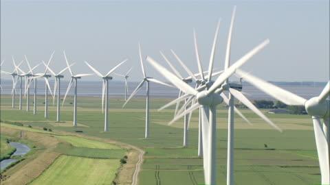aerial ms view of wind turbine on grass field/ niebuell+luebkekoog, schleswig-holstein, germany - wind power stock videos & royalty-free footage