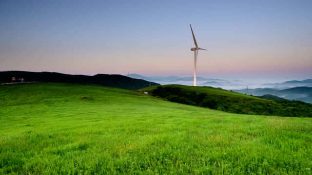 View of wind turbine on the green fields of Daegwallyeong Sky Ranch (popular travel destination)