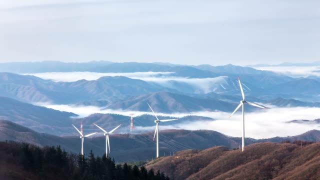 stockvideo's en b-roll-footage met view of wind turbine spinning at mt.taegisan - watervorm