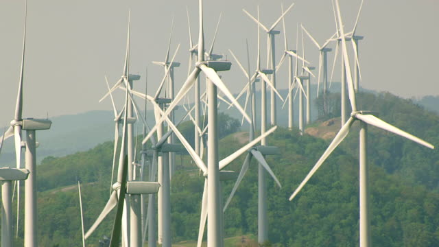 MS AERIAL View of wind turbines spinning at Laurel Mountain Wind Farm in Randolph County / West Virginia, United States