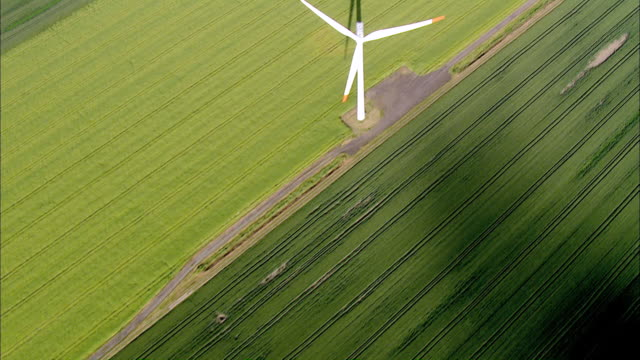 aerial ms view of windmill surrounded by grass field / hochdonn, schleswig-holstein, germany - schleswig holstein stock videos & royalty-free footage
