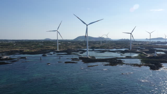 View of windmills beside Shinchang Coastal Road (Famous for beautiful coastline road and wind turbines in Jeju)