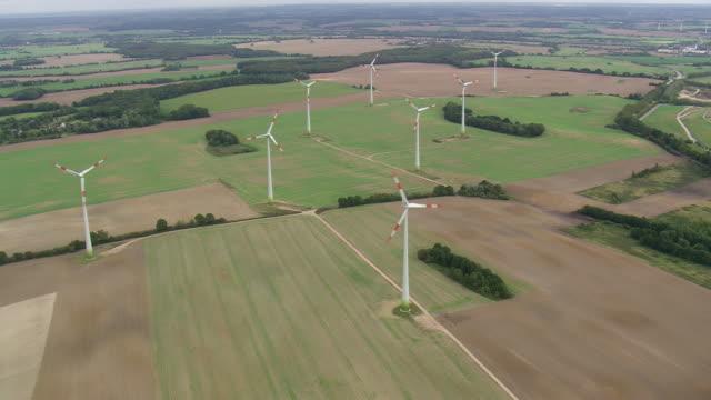 WS AERIAL ZI View of windmills in farmland / Germany