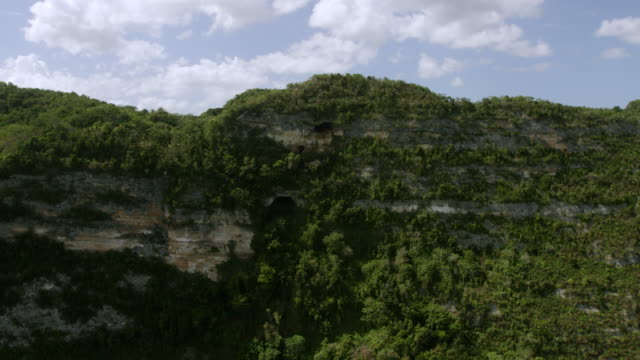 WS AERIAL POV View of Window Cave on top of cliff / Cueva Ventana, Arecibo, Puerto Rico, United States