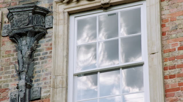 ms view of window with reflection of clouds at kimbolton school / cambridgeshire, united kingdom - palacio stock videos & royalty-free footage