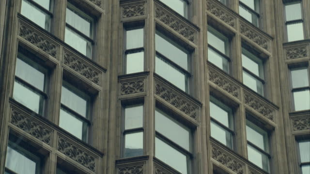 CU TU View of windows of old ornate office building