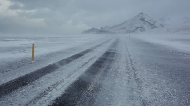 MS View of Winter snow storm blowing on road / Iceland
