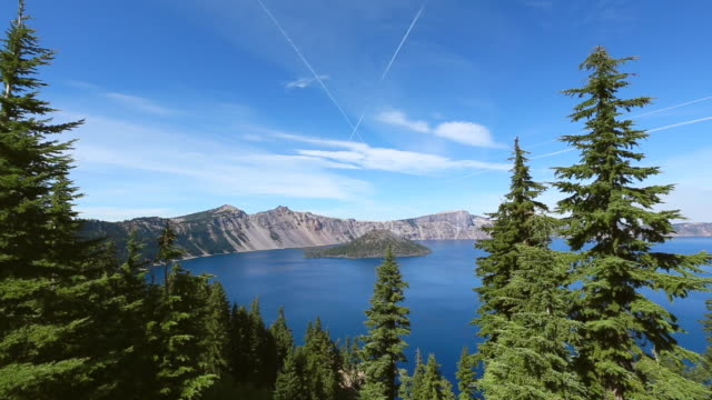 ws view of wizard island through the forest at crater lake / klamath county, oregon, united states - crater lake oregon stock videos & royalty-free footage