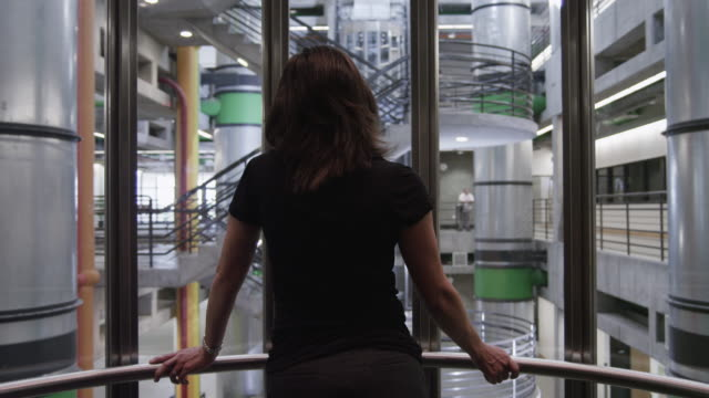 ms pov view of woman in modern elevator in office building / orem, utah, usa - lift stock videos & royalty-free footage