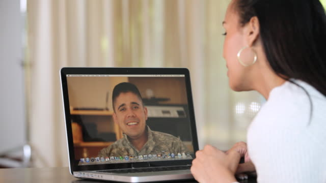 MS CU View of woman talking with soldier on video call / Richmond, Richmond, United States