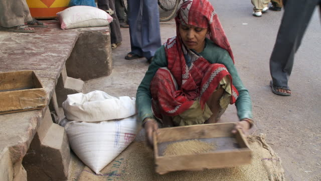 View of women sifting grain