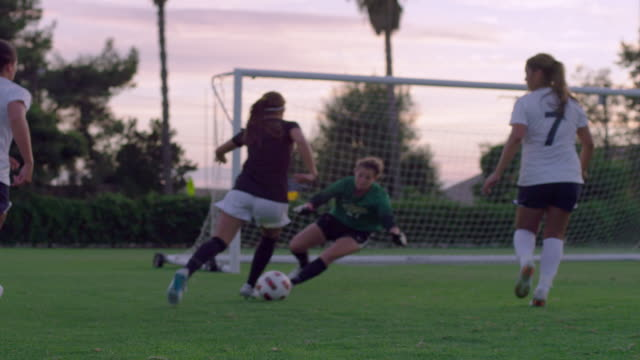 ws td slo mo view of women soccer match / riverside, california, united states - four people stock videos & royalty-free footage