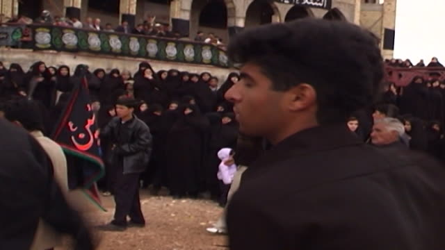 view of women watching men and boys performing azadari rituals during ashura at a mosque in isfahan province ashura the tenth day of the islamic... - ashura muharram stock videos & royalty-free footage