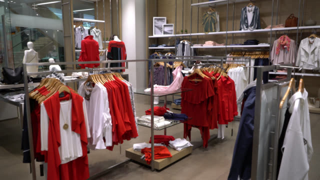 view of women's clothing shop at a mall - retail display stock videos & royalty-free footage