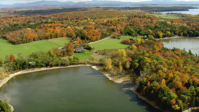 MS AERIAL ZI View of wooded area with autumn color island in Lake Champlain / Vermont, United States