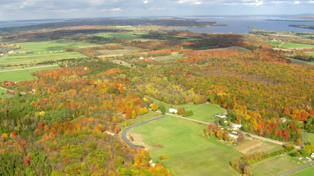 MS AERIAL PAN View of wooded area with autumn color island in Lake Champlain / Vermont, United States