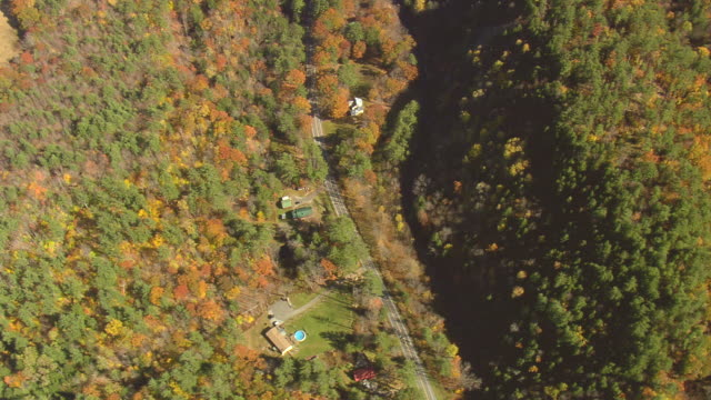 MS AERIAL PAN View of wooded area with autumn color / Vermont, United States