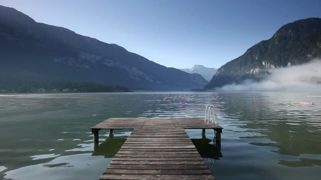 MS View of Wooden jetty on HallstÌ_tter See lake / Salzkammergut region, Upper Austria, Austria