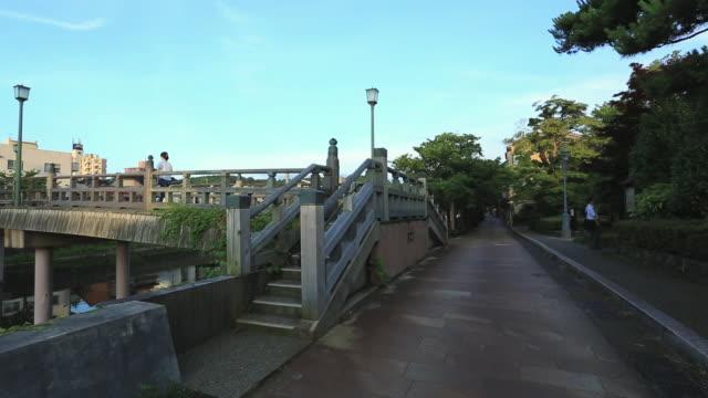 ms pan view of wooden old bridge and nakano-hashi at kazuematchi,shukei machi / kanazawa, ishikawa, japan - kanazawa stock videos and b-roll footage
