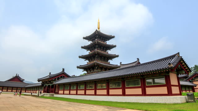 view of wooden pagoda and tourist in baekje cultural land - 尖り屋根点の映像素材/bロール