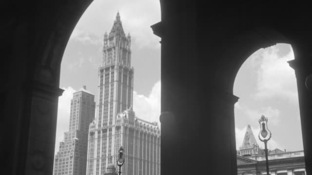 ws view of woolworth tower from entrance of municipal building in new york - woolworth building stock videos & royalty-free footage