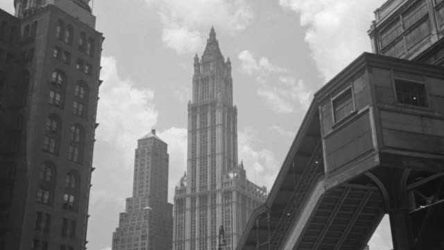 ws view of woolworth tower from sidewalk in new york - woolworth building stock videos & royalty-free footage