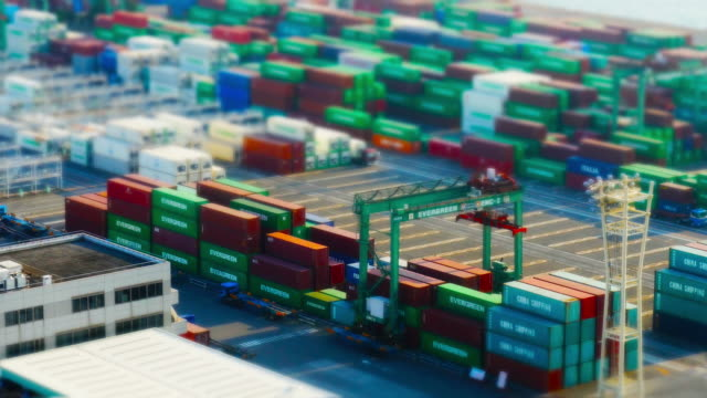 vídeos y material grabado en eventos de stock de view of work at a cargo container port - tilt shift