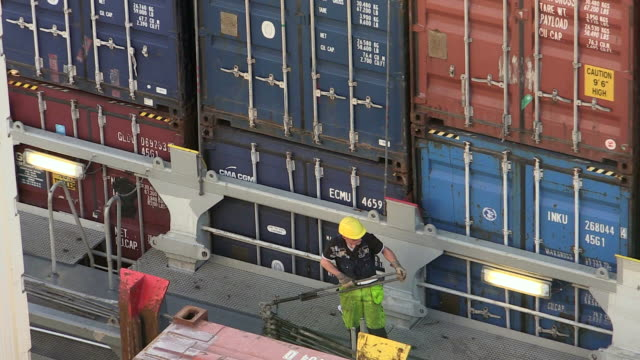 WS T/L View of worker unlock container on ship / Hamburg, Germany