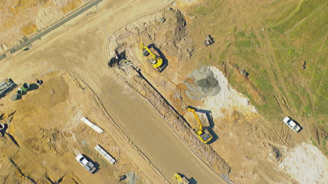 ms aerial zo view of worker working in open landscape for raw houses / sydney, new south wales, australia - terraced house stock videos & royalty-free footage