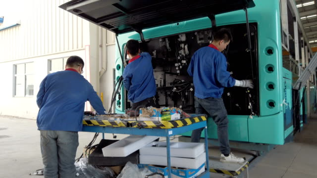 view of workers working in bus factory - aluminum sheet stock videos and b-roll footage