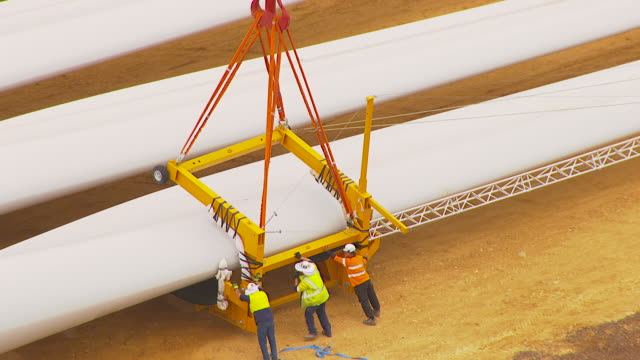 MS AERIAL DS View of workers working on windmill / Macarthur, Victoria, Australia