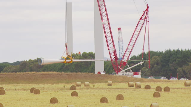 ms aerial zi zo view of workers working on windmill / macarthur, victoria, australia - stehen stock-videos und b-roll-filmmaterial