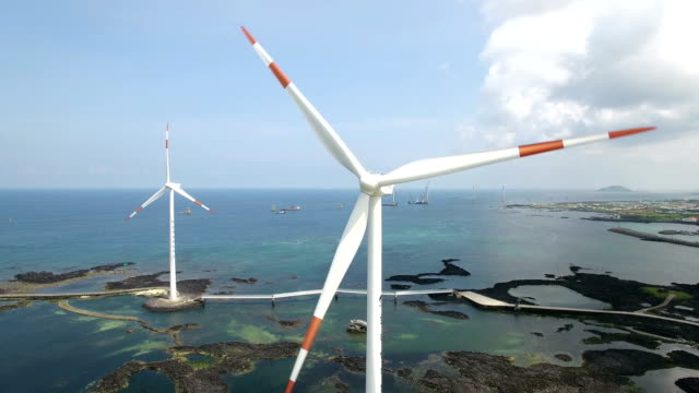 view of working wing of wind turbines in shinchang windmill coast - wind turbine stock videos & royalty-free footage