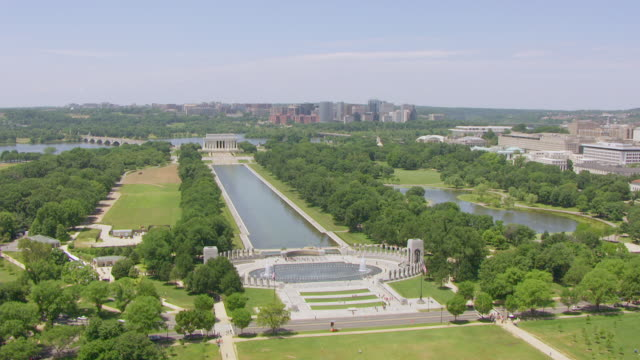 WS AERIAL POV View of World War II Memorial and Reflecting Pool, Lincoln Memorial seen in background / Washington DC, United States