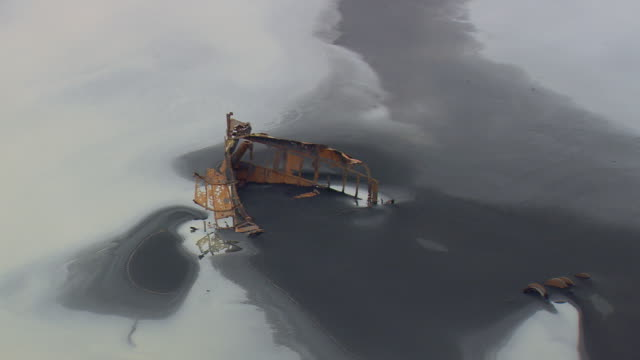 ws aerial view of wreck on south coast / iceland - shipwreck stock videos and b-roll footage
