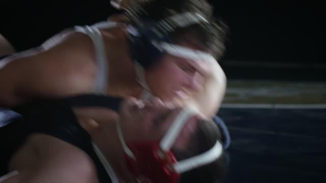 stockvideo's en b-roll-footage met ms tu pan view of wrestling macth one wrestler win macth / riverside, california, united states - worstelen