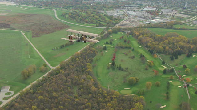 ws ts aerial view of wright b flyer airplane flying over countryside / ohio, united states - wright flyer stock-videos und b-roll-filmmaterial