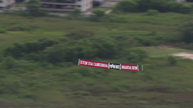 WS AERIAL TS View of Writing on flying plane banner/ Rio de Janeiro, Brazil