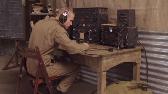 ms view of ww2 radio operator 2 / horsham, west sussex, united kingdom - handhaben stock-videos und b-roll-filmmaterial